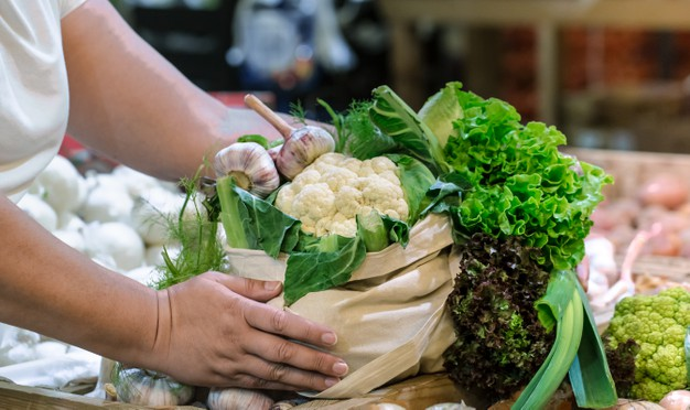 woman-s-hands-holding-fresh-ripe-organic-broccoli-salad-with-greens-vegetables-cotton-bag-weekend-farmer-s-market_169016-5707